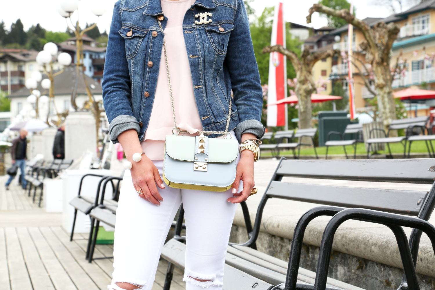outfit-denim-jacket-chanel-brooch-white-ripped-jeans-valentino-glam-lock-bag