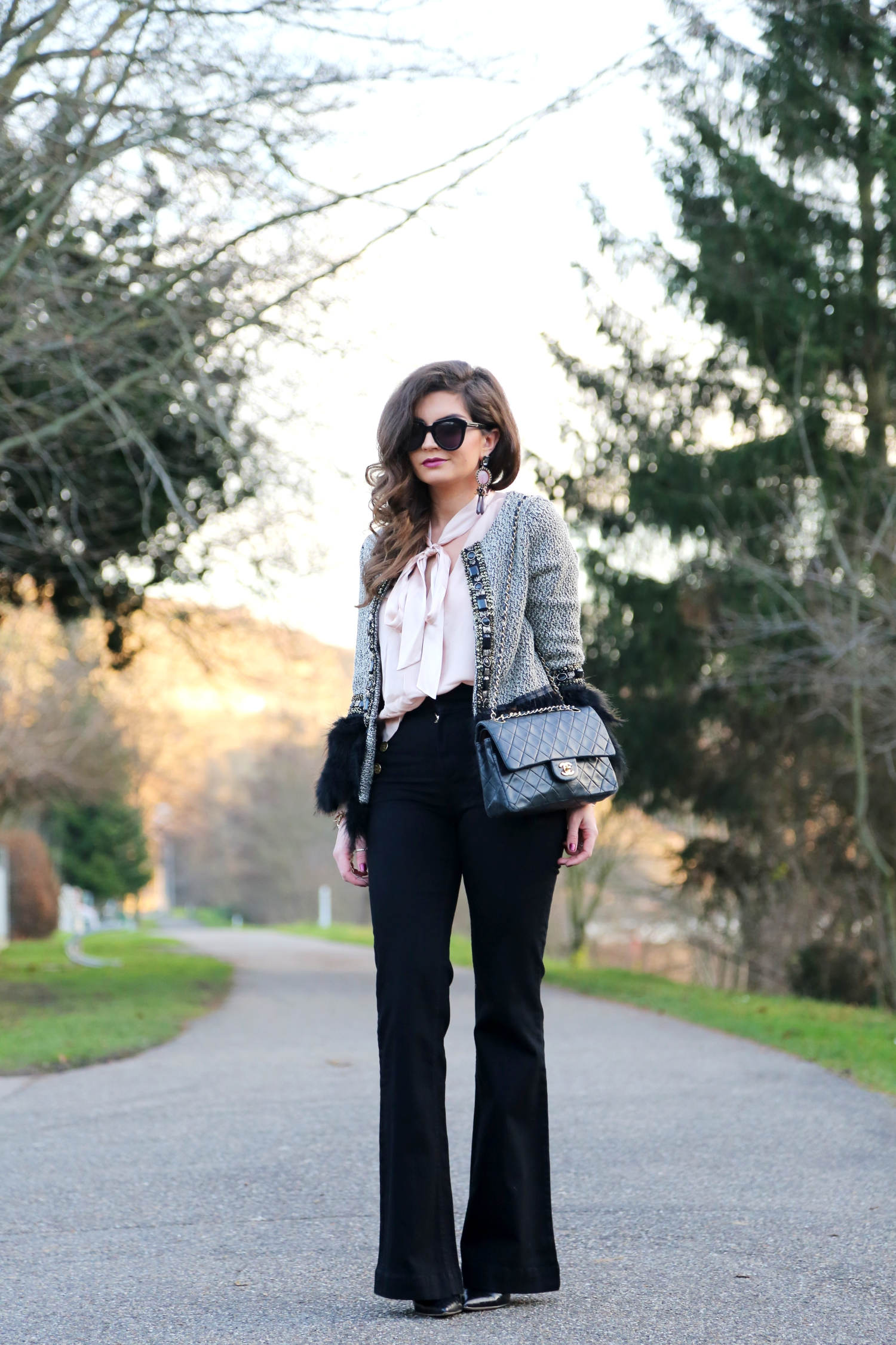 christmas-outfit-flared-jeans-faux-coat-karenwalker-sunglasses-chanel-bag
