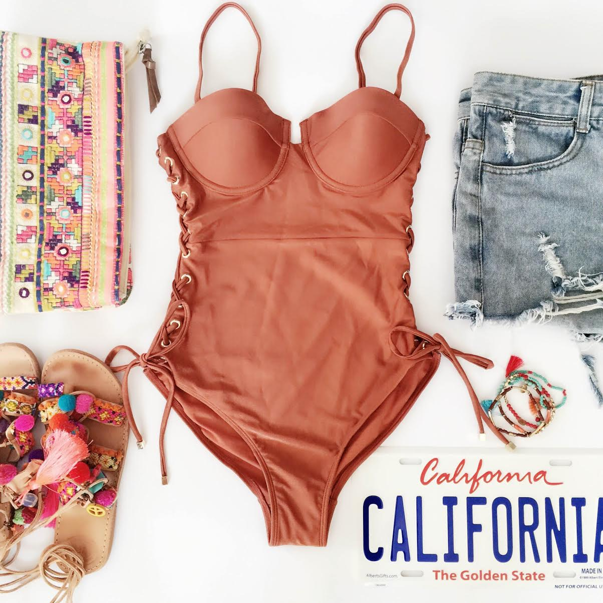 coachella-outfits-california-swimsuit-ripped-denim-shorts