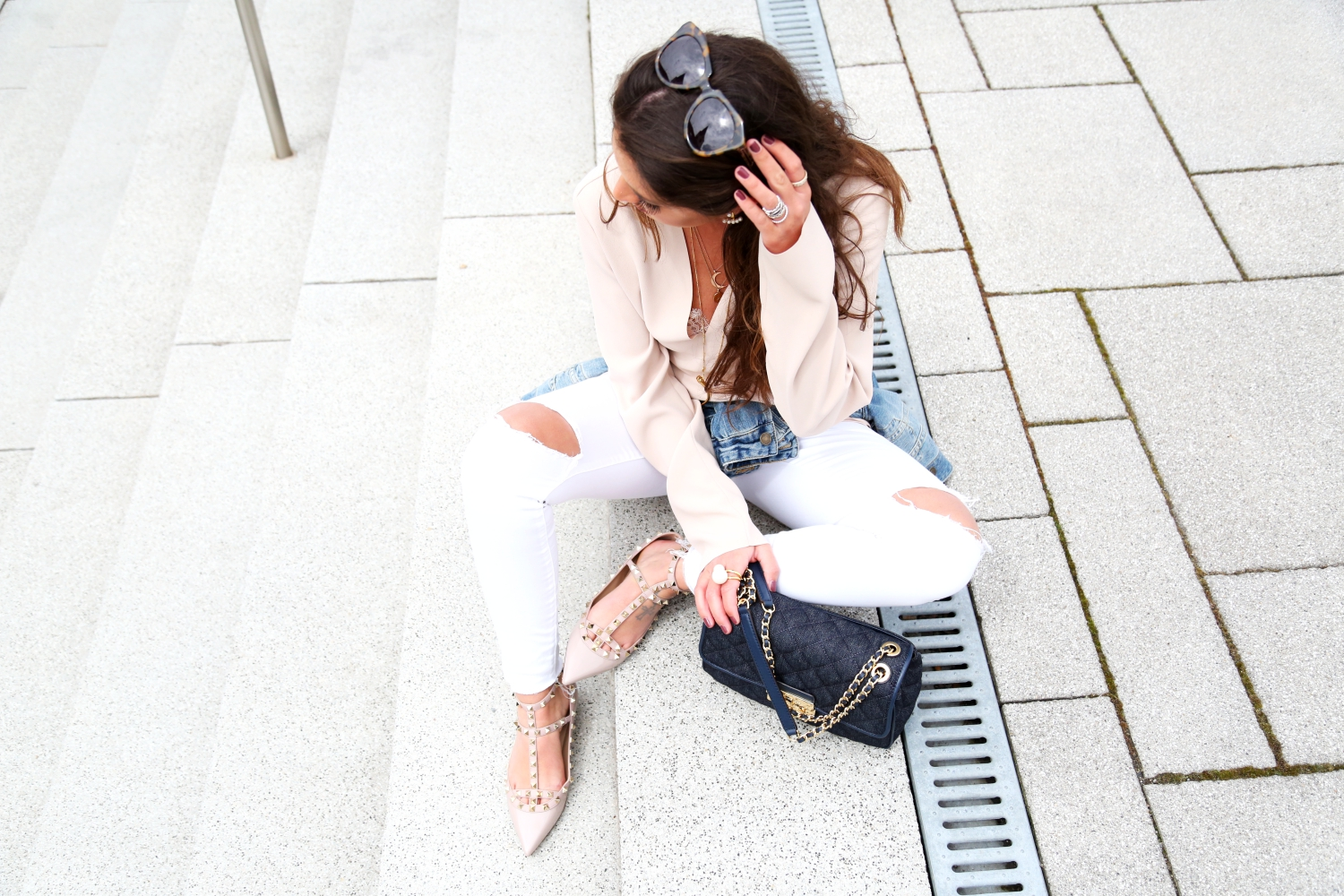 outfit-denim-look-white-jeans-ripped-pants-rockstud-flats-denim-bag-iro-paris-blouse-