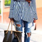 ripped jeans and a striped blouse
