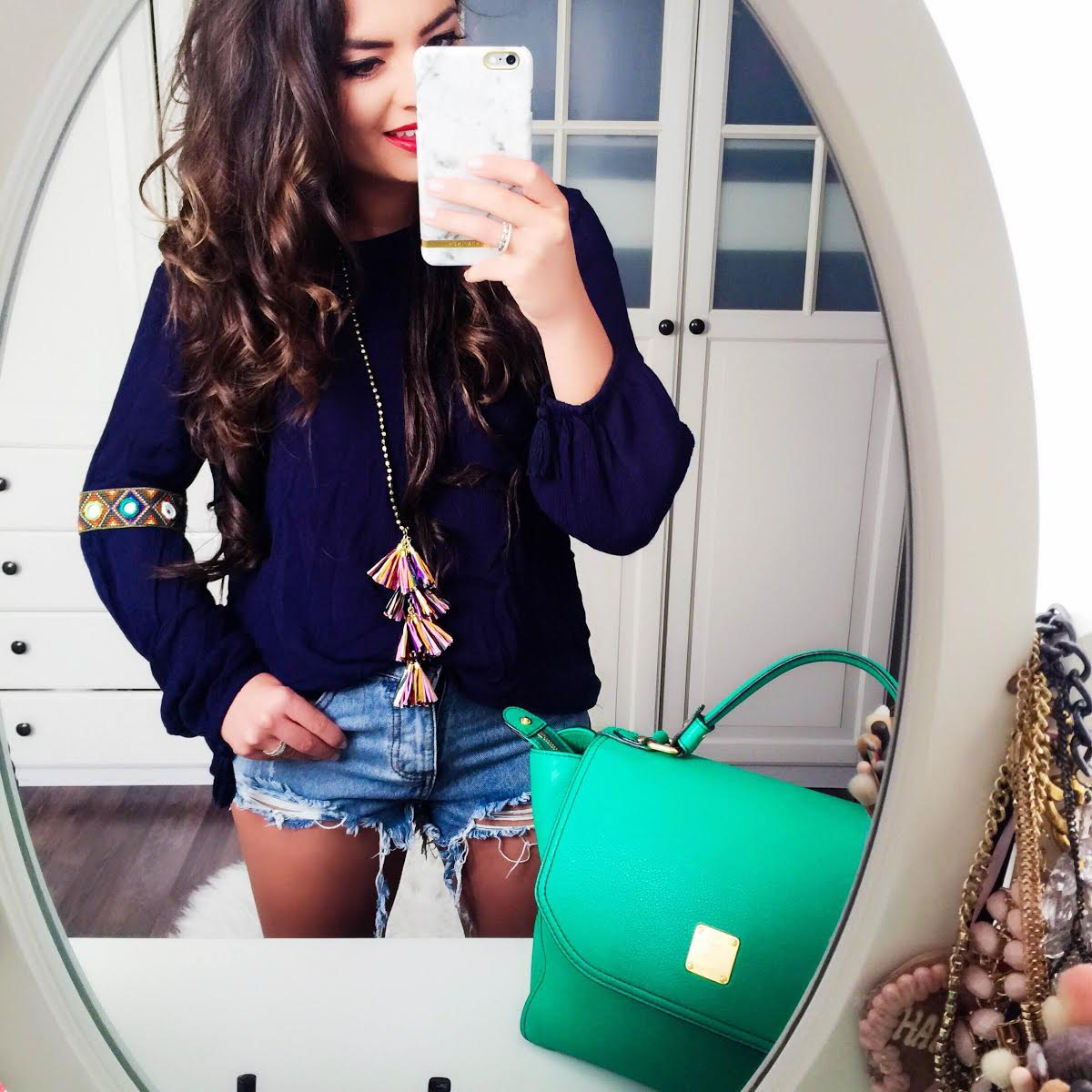 outfit-hippie-blouse-ripped-jeansshorts-mcmbag-green