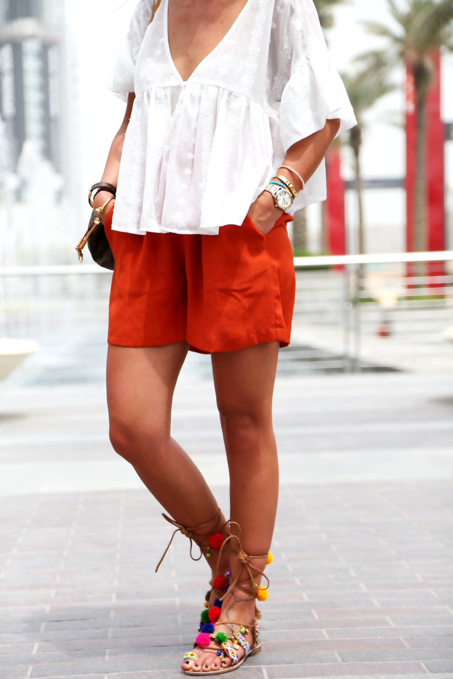 outfit-dubai-mall-edited-shorts-pompom-sandals-white-blouse