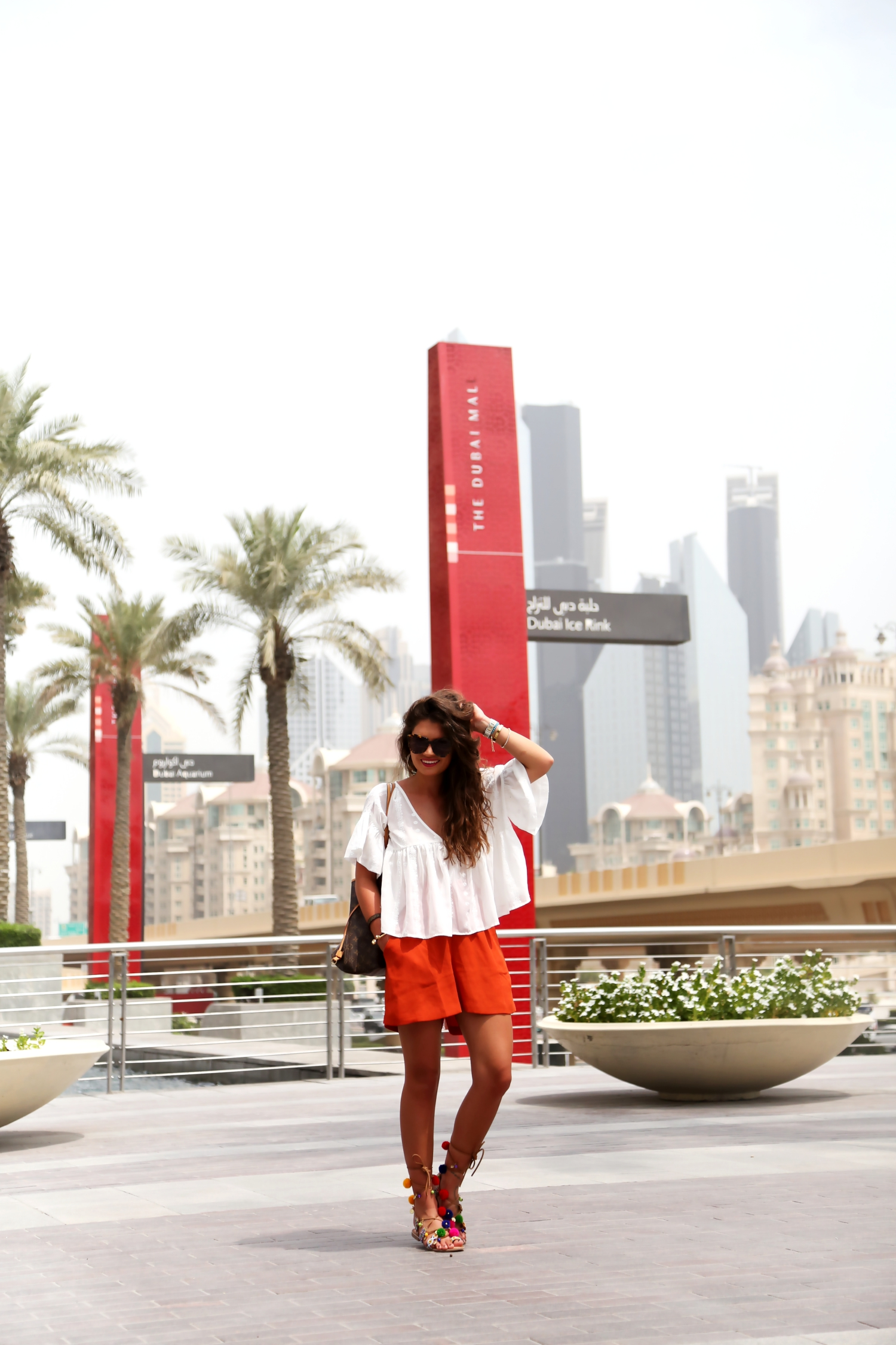 outfit-dubai-mall-pompom-sandals-white-blouse-edited-shorts