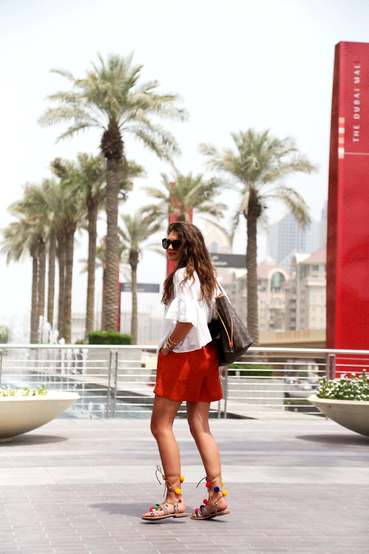outfit-pompom-sandals-edited-shorts-louisvuitton-bag-edited-shorts