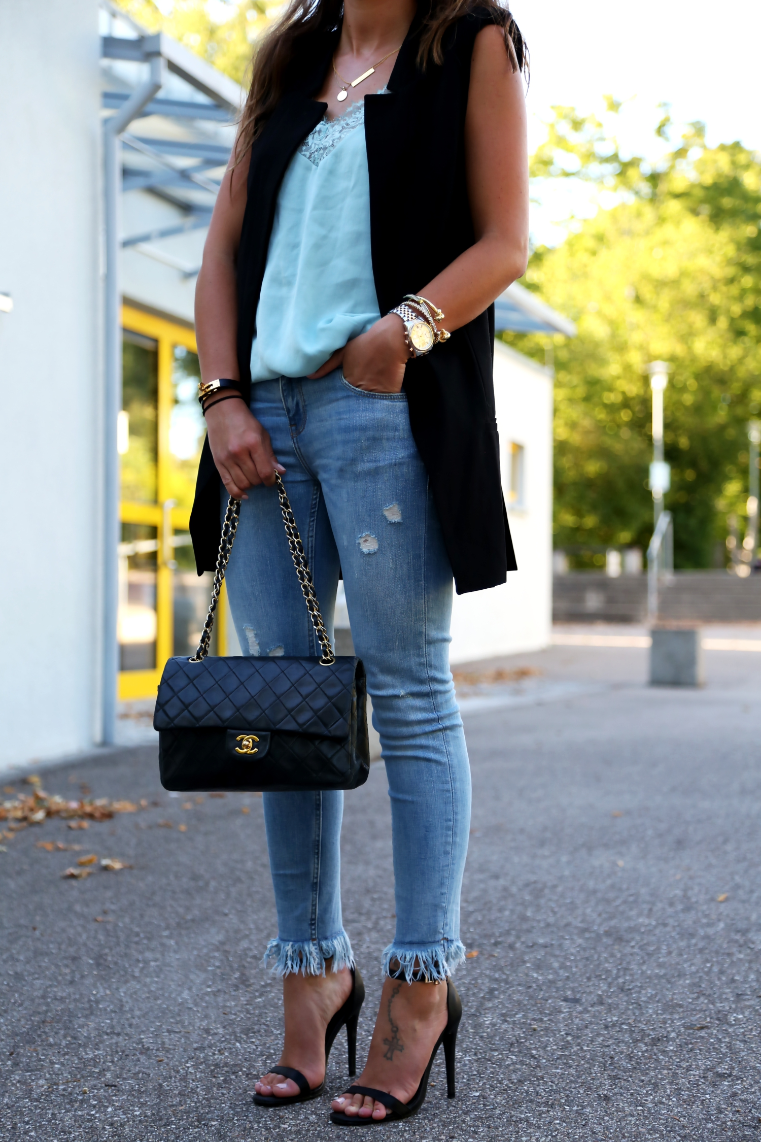 outfit-details-fringe-jeans-vest-chanel-bag-lace-top