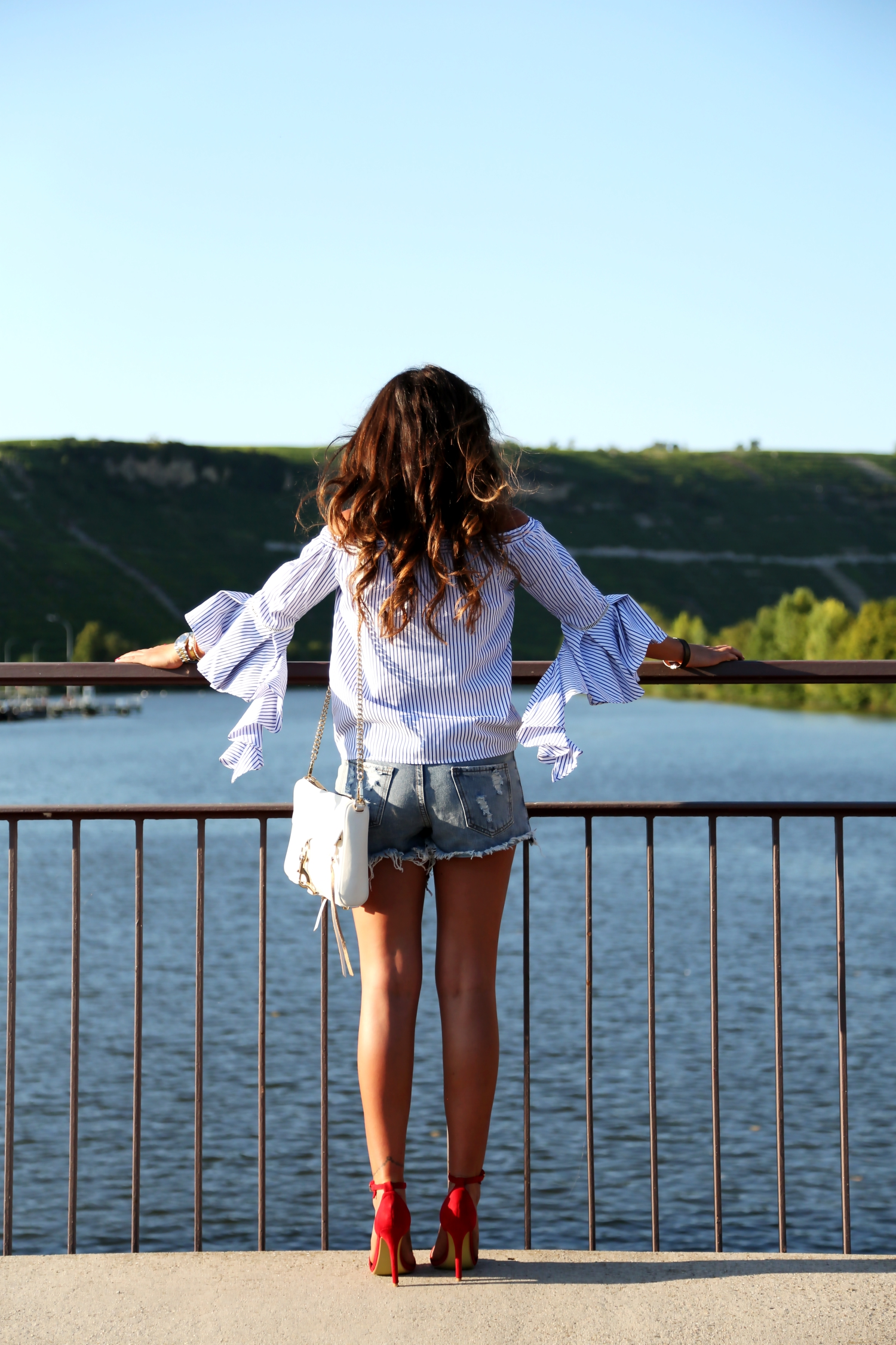 outfit-details-off-shoulder-top-ripped-denim-shorts-red-sandals