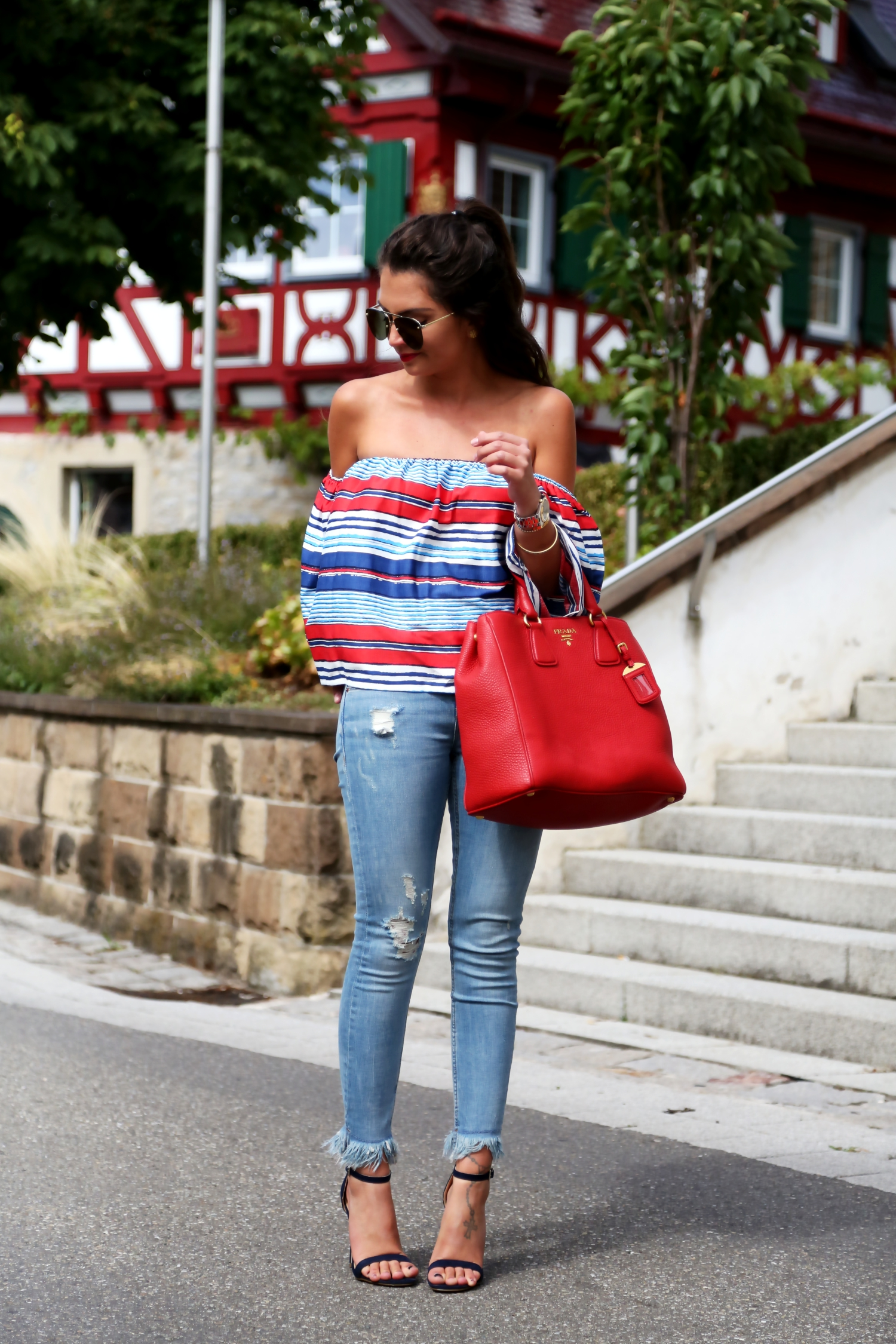 outfit-fringe-jeans-off-shoulder-top-prada-bag