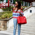 stripes, a fringe jeans and mirrored sunglasses