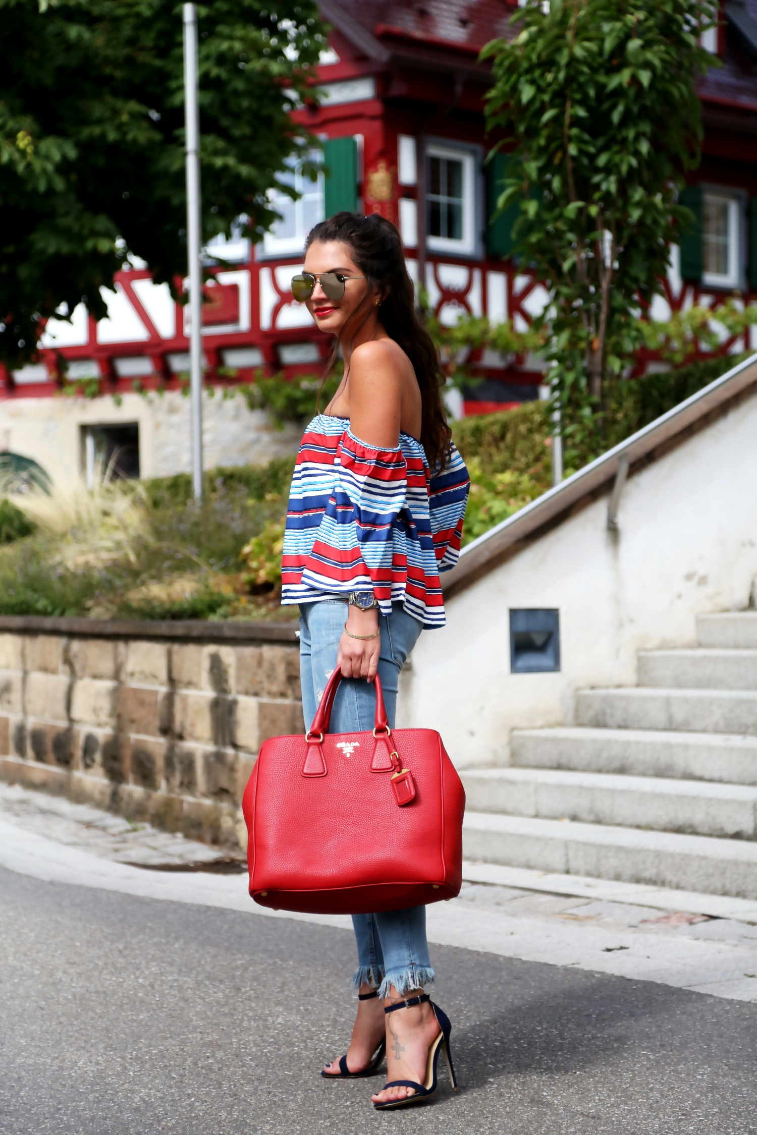 outfit-stripes-off-shoulder-top-fringe-ripped-jeans-prada-bag