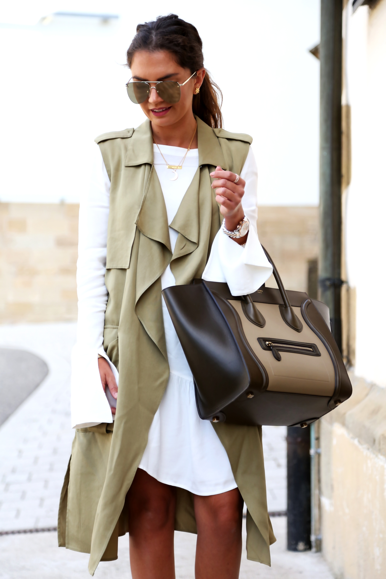 outfit-edited-long-blouse-white-vest-celine-luggage-bag