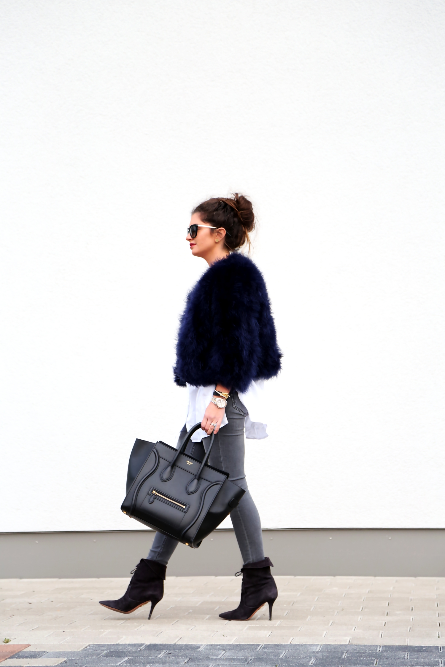 outfit-feather-jacket-ripped-jeans-booties-fall-celine-bag