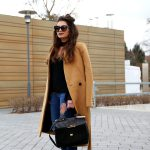 outfit: camel coat , studded booties and a ripped jeans
